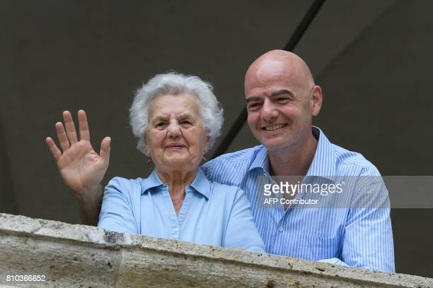President Gianni Infantino waves next to his mother Maria prior to the 'Gianni's game the match of legends' a football match with football legends in...