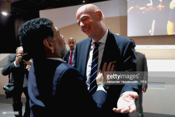President Gianni Infantino welcomes FIFA Legend Diego Maradona for the 67th FIFA Congress at the Bahrain International Congress Convention Center on...