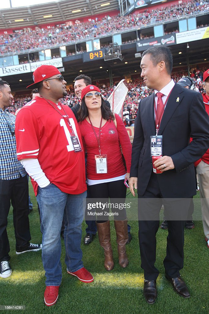 President Gideon Yu of the San Francisco 49ers talks with Pablo Sandoval of the San Francisco Giants during the game against the St. Louis Rams at Candlestick Park on November 11, 2012 in San Francisco, California. The 49ers and Rams tied the game at 24 point.