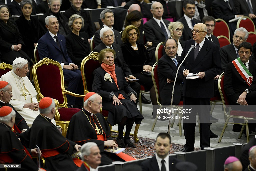 President Giorgio Napolitano (R) delivers his speech to Pope Benedict XVI before the concert directed by Indian conductor Zubin Metha and the Orchestra del Maggio Fiorentino on February 4, 2013, in the Sala Nervi in the Vatican, to mark the 84th Lateran pacts anniversary. AFP PHOTO / ANDREAS SOLARO