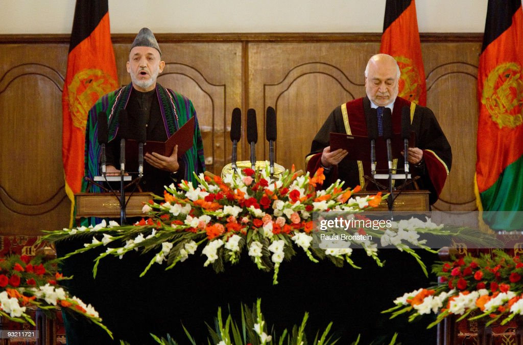 President Hamid Karzai recites the oath of office during the Inauguration ceremony at the presidential palace on November 19 2009 in Kabul...