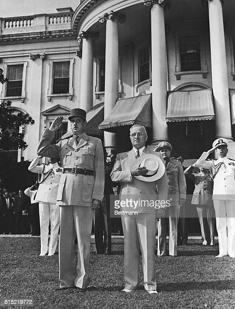 President Harry S Truman stands alongside French provisional President General Charles de Gaulle on the South Lawn of the White House during the...
