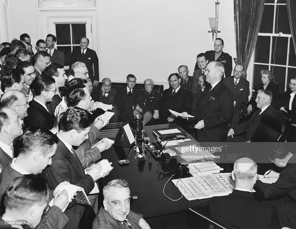 President <a gi-track='captionPersonalityLinkClicked' href=/galleries/search?phrase=Harry+Truman&family=editorial&specificpeople=91039 ng-click='$event.stopPropagation()'>Harry Truman</a> as he reads the Victory Proclamation to the press corps, officially announcing the end of the war in Europe, Washington DC, May 8, 1945. Gathered around are L-R in rear: Elmer Davis (hand to head); Secretary of Commerce Henry A. Wallace; Major General Philip Fleming; Rep. Joseph Martin; General of the Army George C. Marshall; J. Leonard Reinsch; Col. Harry Vaughan; <a gi-track='captionPersonalityLinkClicked' href=/galleries/search?phrase=John+W.+Snyder&family=editorial&specificpeople=224563 ng-click='$event.stopPropagation()'>John W. Snyder</a>; Mrs. Truman; Margaret Truman; and Secretary of War Henry L Stimson. In center foreground looking at camera is Fred M. Vinson.
