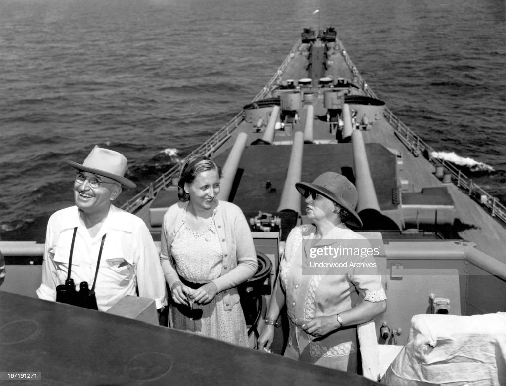 President <a gi-track='captionPersonalityLinkClicked' href=/galleries/search?phrase=Harry+Truman&family=editorial&specificpeople=91039 ng-click='$event.stopPropagation()'>Harry Truman</a>, Mrs Truman,and their daughter, Margaret, on board the USS Missouri as they watch firing practice of the ship's 16 inch guns, Atlantic Ocean, September 18, 1947. The First Family is returning from the state visit to Brazil.