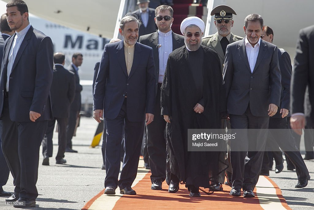 President Hassan Rouhani of Iran (C), Ali Akbar Velayati (L) advisor to the Islamic republic's supreme leader Ayatollah Ali Khamenei and Eshaq Jahangiri (R) the First Vice President arrive at Mehrabad Airport on September 28, 2013 in Tehran, Iran. Hardline Islamists gathered outside the airport to chant ''Death to America'' and ''Death to Israel'' but they were outnumbered by supporters of President Rouhani who shouted 'Thank you Rouhani.' Iranian newspapers hailed the first contact between presidents Rouhani and Obama but warned that Israel would seek to impede the historic opening to Washington.