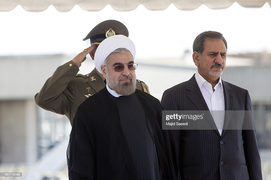 President Hassan Rouhani of Iran (L) and First Vice President Eshaq Jahangiri arrive at Mehrabad Airport on September 28, 2013 in Tehran, Iran. Hardline Islamists gathered outside the airport to chant ''Death to America'' and ''Death to Israel'' but they were outnumbered by supporters of President Rouhani who shouted 'Thank you Rouhani.' Iranian newspapers hailed the first contact between presidents Rouhani and Obama but warned that Israel would seek to impede the historic opening to Washington.