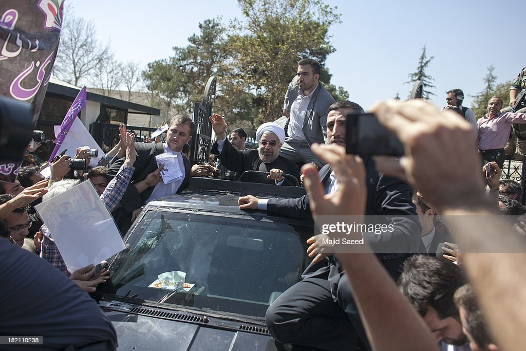 President Hassan Rouhani of Iran waves to supporters as his motorcade leaves Mehrabad Airport on September 28, 2013 in Tehran, Iran. Hardline Islamists gathered outside the airport to chant ''Death to America'' and ''Death to Israel'' but they were outnumbered by supporters of President Rouhani who shouted 'Thank you Rouhani.' Iranian newspapers hailed the first contact between presidents Rouhani and Obama but warned that Israel would seek to impede the historic opening to Washington.