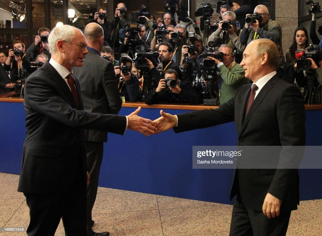 EU President <a gi-track='captionPersonalityLinkClicked' href=/galleries/search?phrase=Herman+Van+Rompuy&family=editorial&specificpeople=4476281 ng-click='$event.stopPropagation()'>Herman Van Rompuy</a> (L) greets Russian President <a gi-track='captionPersonalityLinkClicked' href=/galleries/search?phrase=Vladimir+Putin&family=editorial&specificpeople=154896 ng-click='$event.stopPropagation()'>Vladimir Putin</a> (R) during the Russia-EU Summit on January 28, 2014 in Brussels, Belgium. Putin is in a one-day visit to Brussels.