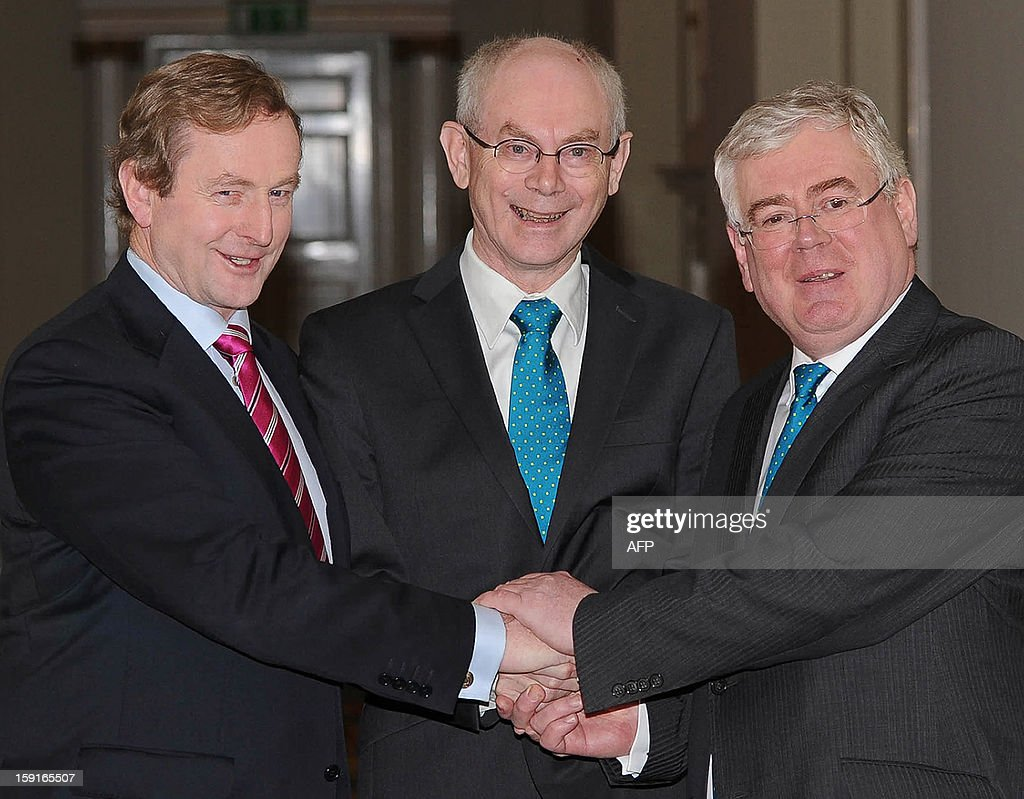 EU President Herman Van Rompuy (C) is welcomed by Irish President Enda Kenny (L) and Irish Minister for Foreign Affairs and Trade, Eamon Gilmore (R) in Dublin, Ireland, on January 9, 2013. Ireland has taken over the EU Presidency from Cyprus beginning January 1st. AFP PHOTO/ Artur Widak