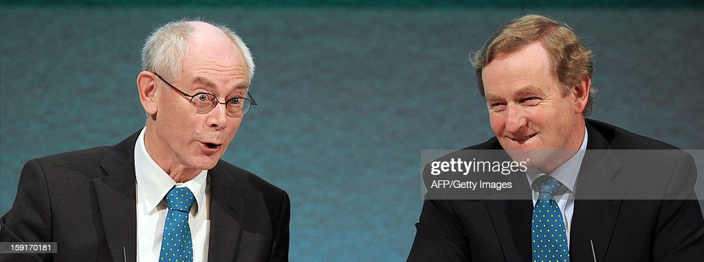 EU President Herman Van Rompuy (C) speaks during a joint press conference with Irish President Enda Kenny (R) and Irish Minister for Foreign Affairs and Trade Eamon Gilmore (unseen) in Dublin, Ireland, on January 9, 2012 as Ireland begin its six-month presidency of the European Union.