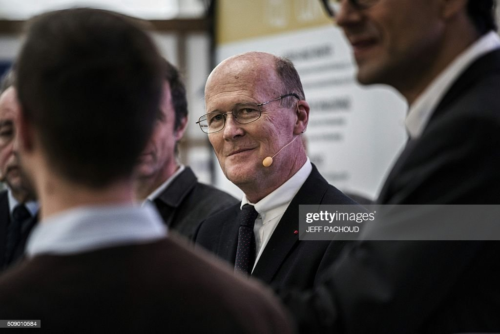 president Hubert Du Mesnil looks on during an award ceremony to choose the new logo for TELT, a TGV high speed train rail line project connecting Lyon and Turin, on February 8, 2016, in the Confluence museum in Lyon, central-eastern France. / AFP / JEFF PACHOUD