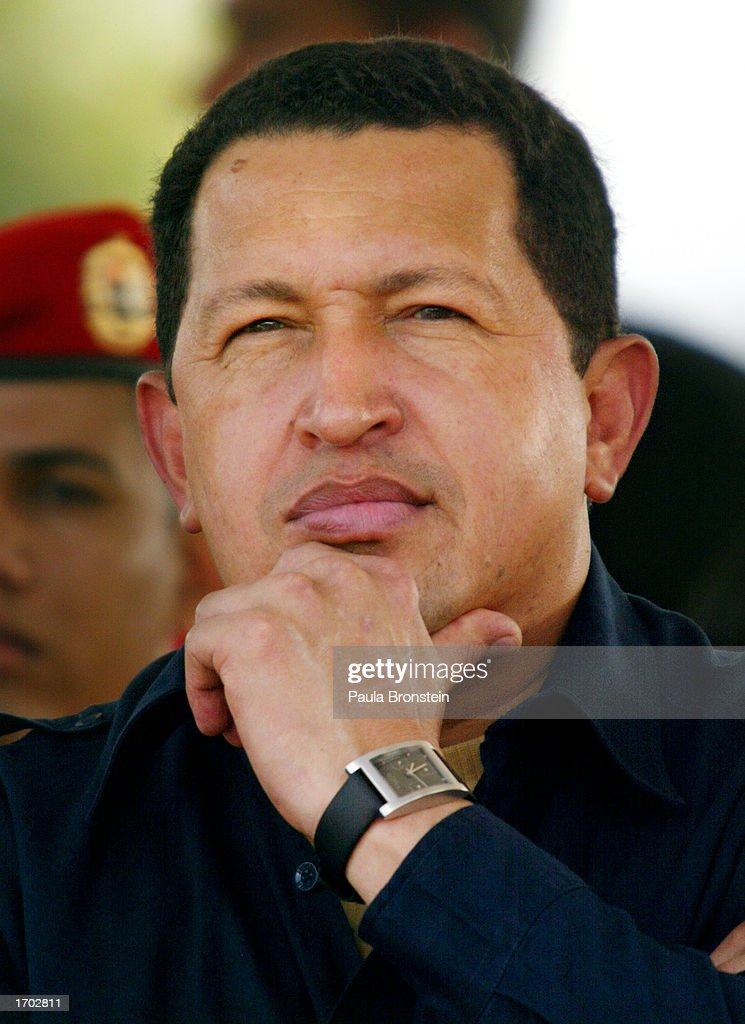 President Hugo Chavez listens to a speech at a fuel distribution plant located 93 miles east of Caracas December 27, 2002 in Carenero, Venezuela. Chavez decorated military and oil workers who were involved in the recovery of the Pilin Leon vessel whose crew had stranded the oil tanker in Maracaibo Lake. Venezuela is in its fourth week of a crippling strike that has virtually shut down Venezuela's vital oil industry.