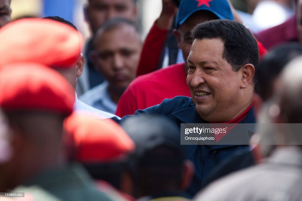 President Hugo Chavez waves supporters as he arrives to vote in the presidential elections. Chavez seeks reelection against the candidate of the MUD party, Henrique Capriles.