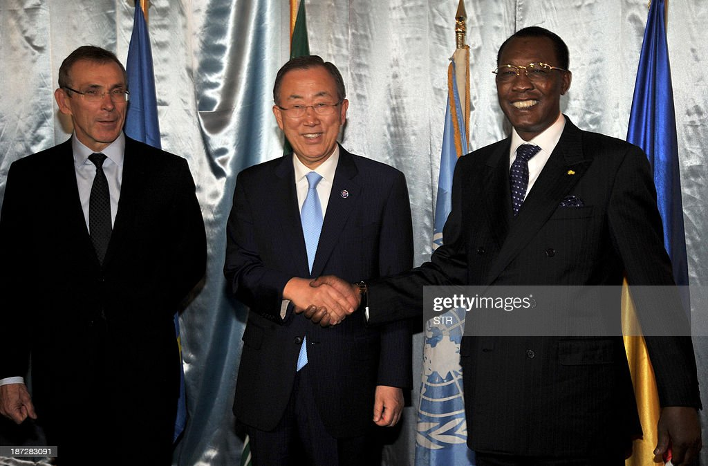 President Idriss Deby Itno of Chad poses with UN secretary general Ban KiMoon next to EU development commissioner Andris Piebalgs after their meeting...
