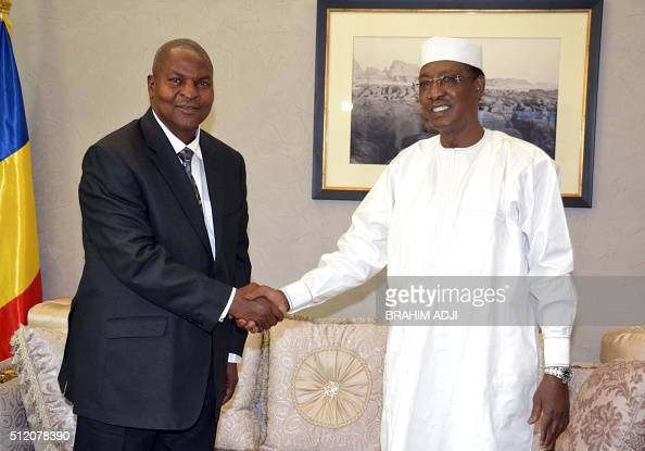 President Idriss Deby of Chad shakes hands with Central African Republic new elected President Faustin Archange Touadera at the presidential palace...