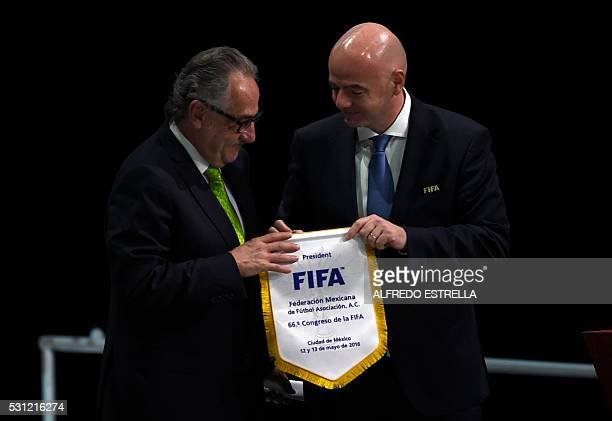 FIFA president Italian Gianni Infantino gives a FIFA pennant to the president of the Mexican Football Federation Decio de Maria during the second day...