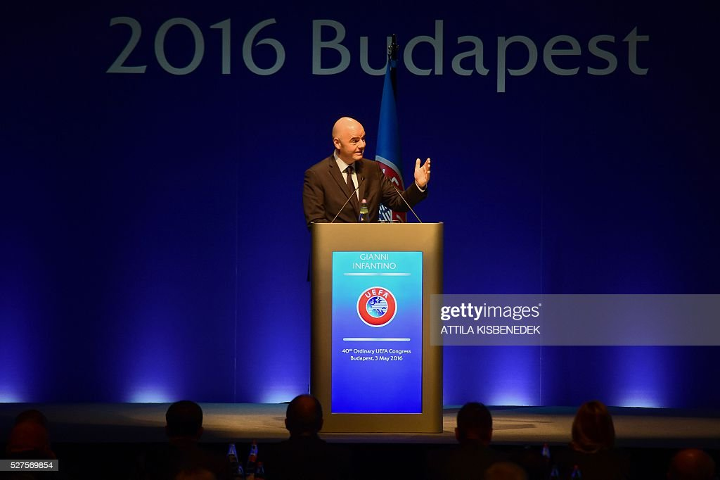 President Italian-Swiss Gianni Infantino gives a speech during the 40th Ordinary UEFA Congress at the Hungexpo Fair Center in Budapest on May 3, 2016. Infantino appealed to Europe's wealthy football nations to donate money they get from the world body to poorer countries. / AFP / ATTILA