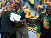 President Jacob Zuma and ANC Gauteng chairman Paul Mashatile hug each other during the Gauteng ANC manifesto launch at FNB Stadium on June 04 2016 in...