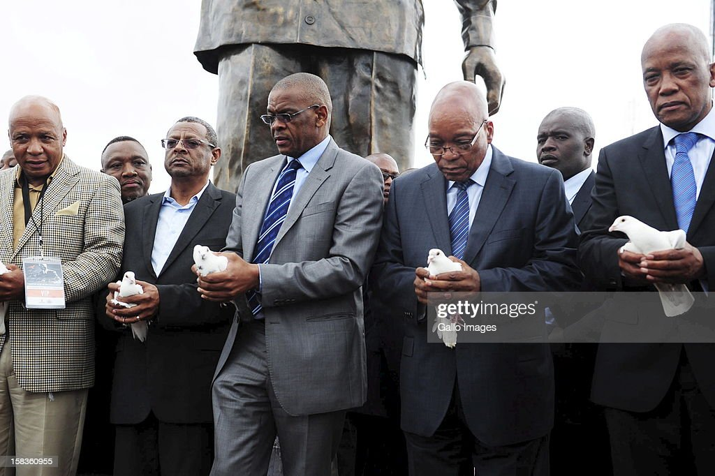 President Jacob Zuma and the premier of the Free State Ace Magashule ready to release white doves during the Nelson Mandela statue unvailing in Mangaung at Naval Hill on December 13, 2012, in Bloemfontein, South Africa.