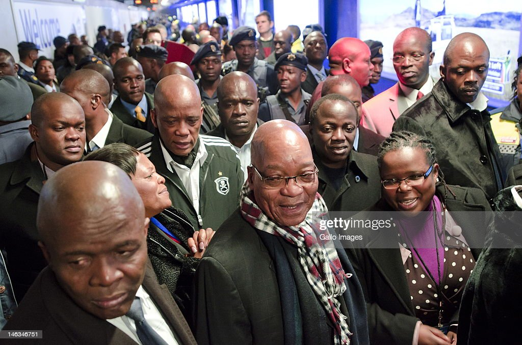 President Jacob Zuma, Ben Martins and <a gi-track='captionPersonalityLinkClicked' href=/galleries/search?phrase=Collins+Chabane&family=editorial&specificpeople=7662781 ng-click='$event.stopPropagation()'>Collins Chabane</a> ride public transportion during rush hour from the Sandton Gautrain station on June 14, 2012 in Johannesburg, South Africa. In an attempt to test the efficiency of the country's public transport system, President Zuma travelled from Pretoria to Soweto using only public transport during rush hour. He was accompanied by Gauteng Premier Nomvula Mokonyane, Minister of Finance Pravin Gordhan, Minister of Transport Ismail Vadi and Gautrain Management CEO Jack van der Merwe.