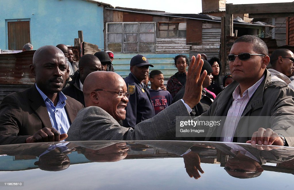 President <a gi-track='captionPersonalityLinkClicked' href=/galleries/search?phrase=Jacob+Zuma&family=editorial&specificpeople=564982 ng-click='$event.stopPropagation()'>Jacob Zuma</a> greets residents during a visit to the suburb of Bishop Lavis on July 23, 2011 in Cape Town, South Africa. Zuma's visit to the Western Cape forms part of a drive to revive an ANC recruitment campaign in the Democratic Alliance stronghold.