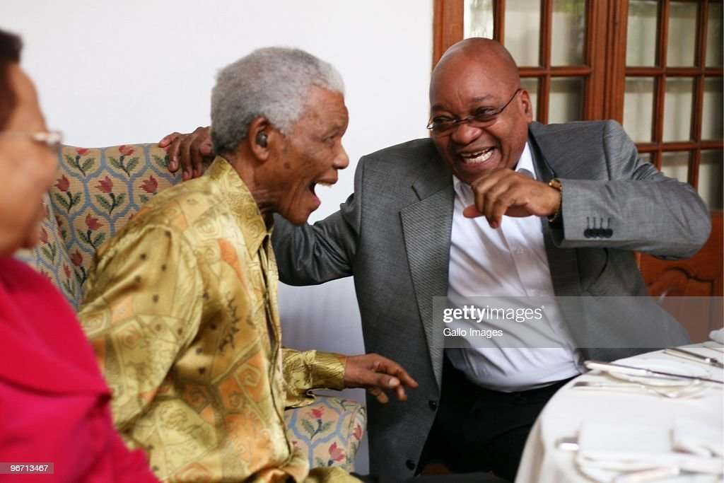 President Jacob Zuma laughs with former South African president Nelson Mandela during a luncheon for men from the Rivonia trials and political veterans on February 12, 2010 in Cape Town, South Africa. The luncheon formed part of the celebration of 20 years since Nelson Mandela was released from prison.