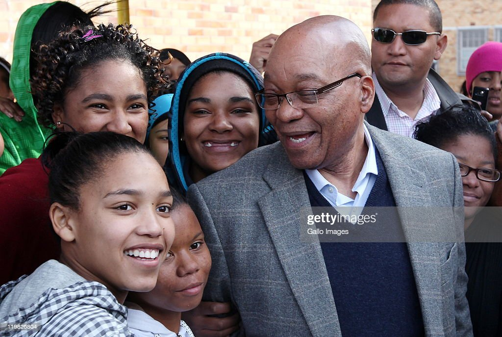 President <a gi-track='captionPersonalityLinkClicked' href=/galleries/search?phrase=Jacob+Zuma&family=editorial&specificpeople=564982 ng-click='$event.stopPropagation()'>Jacob Zuma</a> poses with members of the public during a visit to the suburb of Bishop Lavis on July 23, 2011 in Cape Town, South Africa. Zuma's visit to the Western Cape forms part of a drive to revive an ANC recruitment campaign in the Democratic Alliance stronghold.