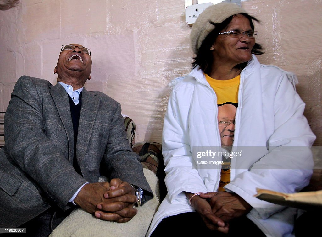 President <a gi-track='captionPersonalityLinkClicked' href=/galleries/search?phrase=Jacob+Zuma&family=editorial&specificpeople=564982 ng-click='$event.stopPropagation()'>Jacob Zuma</a> shares a light moment with resident Maria Josephs during a visit to the suburb of Bishop Lavis on July 23, 2011 in Cape Town, South Africa. Zuma's visit to the Western Cape forms part of a drive to revive an ANC recruitment campaign in the Democratic Alliance stronghold.