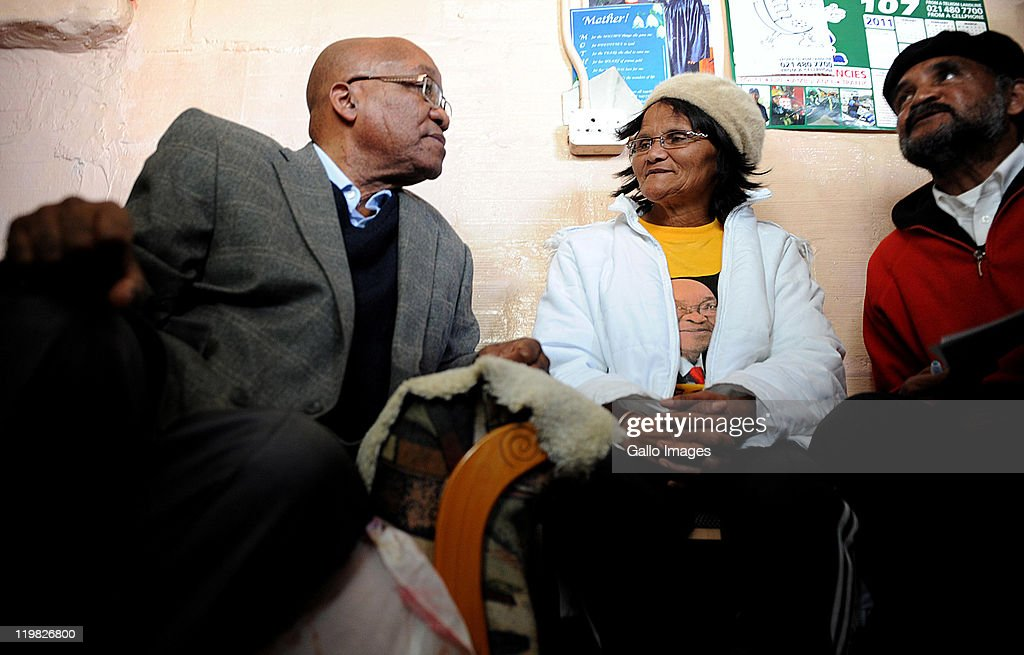 President <a gi-track='captionPersonalityLinkClicked' href=/galleries/search?phrase=Jacob+Zuma&family=editorial&specificpeople=564982 ng-click='$event.stopPropagation()'>Jacob Zuma</a> shares a moment with resident Maria Josephs during a visit in the suburb of Bishop Lavis on July 23, 2011 in Cape Town, South Africa. Zuma's visit to the Western Cape forms part of a drive to revive an ANC recruitment campaign in the Democratic Alliance stronghold.