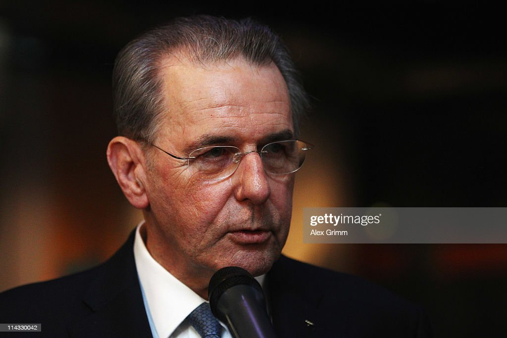 President <a gi-track='captionPersonalityLinkClicked' href=/galleries/search?phrase=Jacques+Rogge&family=editorial&specificpeople=206143 ng-click='$event.stopPropagation()'>Jacques Rogge</a> answers reporters' questions after the briefing for IOC members at the Olympic Museum on May 18, 2011 in Lausanne, Switzerland. The Candidate Cities for the 2018 Olympic Winter Games of Munich (Germany), Annecy (France) and PyeongChang (South Korea), will present the briefing with the technical aspects of their bids, while IOC members will be able to question each bidding city. The final decision will be announced on July 6, 2011 at the IOC Session scheduled to be held in Durban, South Africa.