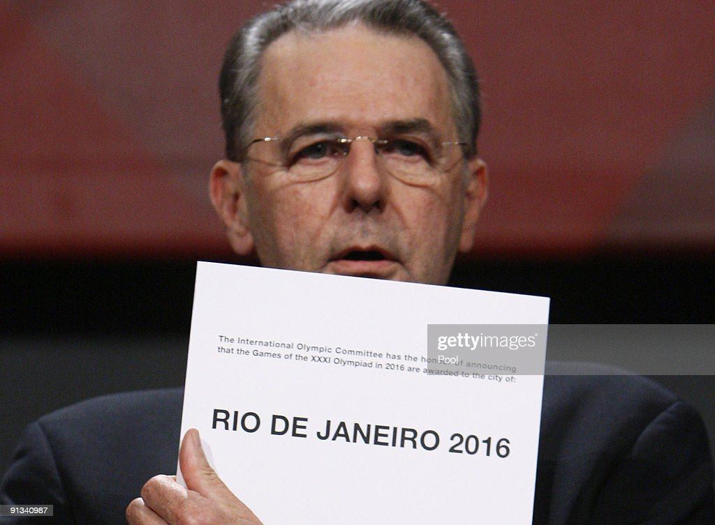 President Jacques Rogge opens the envelope announcing that Rio de Janeiro has won the bid to host the 2016 Summer Olympic Games at the Bella Center...
