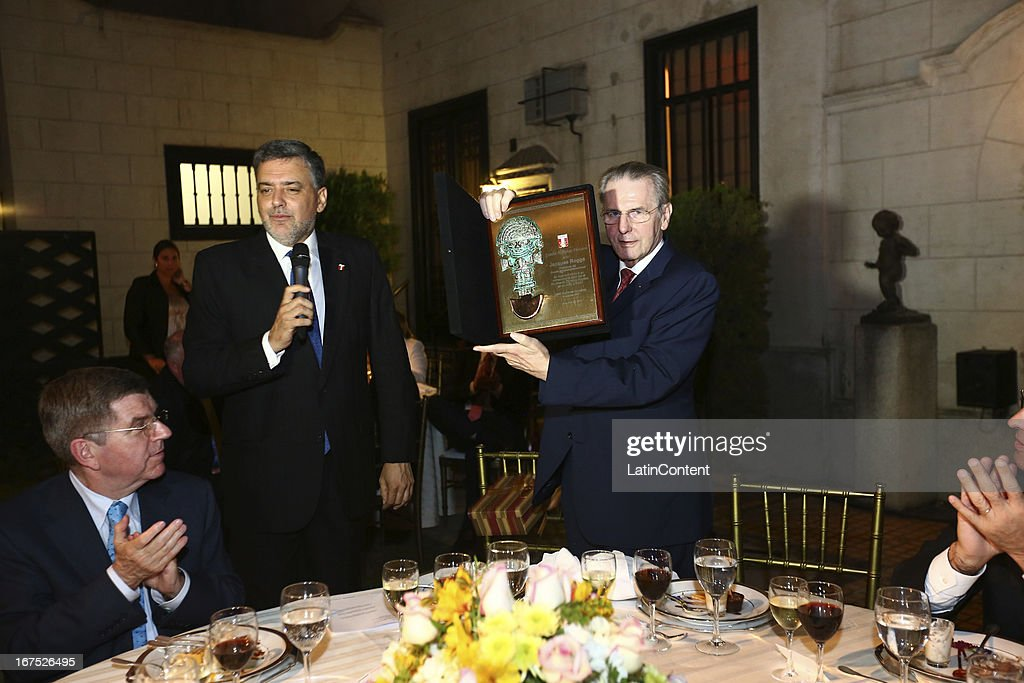 President <a gi-track='captionPersonalityLinkClicked' href=/galleries/search?phrase=Jacques+Rogge&family=editorial&specificpeople=206143 ng-click='$event.stopPropagation()'>Jacques Rogge</a> shows and award given by the Peruvian Olympic Comitte President Jose Quiñones, who delivers a speach during the gala dinner on the second day of the 15th IOC World Conference Sports For All at Casa García Alvarado on April 25, 2013 in Lima, Peru.