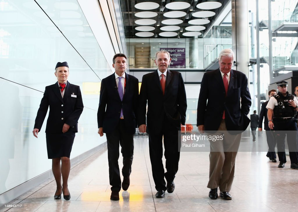 President <a gi-track='captionPersonalityLinkClicked' href=/galleries/search?phrase=Jacques+Rogge&family=editorial&specificpeople=206143 ng-click='$event.stopPropagation()'>Jacques Rogge</a> (2nd R) walks through Heathrow Terminal 5 after being welcomed by Lord <a gi-track='captionPersonalityLinkClicked' href=/galleries/search?phrase=Sebastian+Coe&family=editorial&specificpeople=160624 ng-click='$event.stopPropagation()'>Sebastian Coe</a> (2nd R) and the IOC member for Great Britain Sir Craig Reedie on his arrival for the London 2012 Olympic Games at Heathrow Airport on July 20, 2012 in London, England.