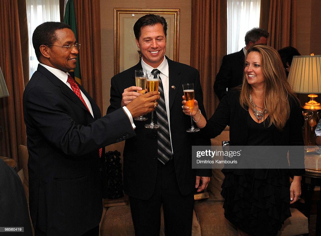 President Jakaya Kikwete, Goodwill Ambassador Doug Pitt and Lisa Pitt toast each other at the Tanzania Education Trust New York Gala hosted by President Jakaya Kikwete of the United Republic of Tanzania at Plaza Athenee on April 19, 2010 in New York City.