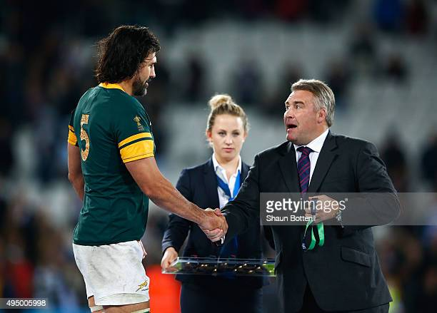 RFU president Jason Leonard shakes hands with Victor Matfield of South Africa as he is presented with his bronze medal after the 2015 Rugby World Cup...
