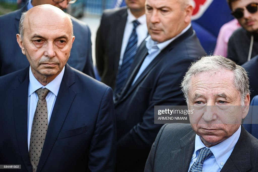 FIA President Jean Todt (R) flanked by Kosovo Prime minister Isa Mustafa (L) looks on during his visit of the Kosovo Automobile Racers in Pristina on May 26, 2016 as part of his first visit to Kosovo. / AFP / ARMEND