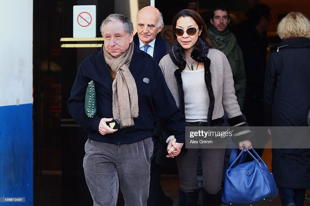FIA president Jean Todt his wife actress Michelle Yeoh and surgeon and Michael Schumacher's friend professor Gerard Saillant leave the Grenoble...