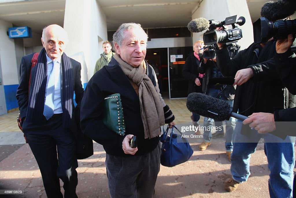 FIA president Jean Todt, his wife actress Michelle Yeoh and surgeon and Michael Schumacher's friend professor Gerard Saillant leave the Grenoble University Hospital Centre where former German Formula One driver Michael Schumacher is being treated for a severe head injury following a skiing accident on Sunday in Meribel on December 31, 2013 in Grenoble, France.