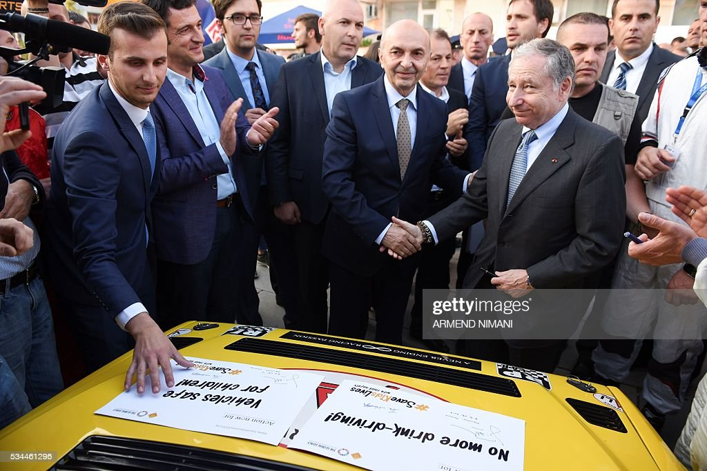 FIA President Jean Todt (R) shakes hands with Kosovo Prime minister Isa Mustafa during his visit of the Kosovo Automobile Racers in Pristina on May 26, 2016 as part of his first visit to Kosovo. / AFP / ARMEND
