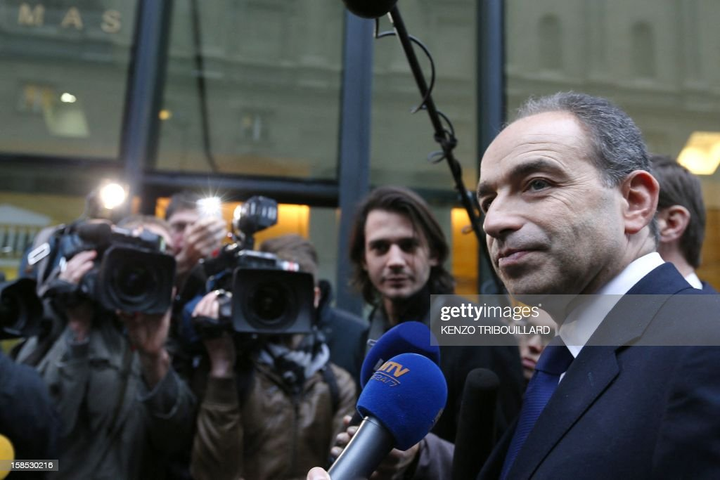 UMP president Jean-Francois Cope (C) answers journalists before a UMP political bureau aiming at validating a new internal election, on December 18, 2012 at the National Assembly in Paris. Cope and Francois Fillon, the rivals in the leadership row which split French former ruling party, the UMP, agreed on December 17, 2012 to a new internal election after a bitterly-contested first vote last month. AFP PHOTO KENZO TRIBOUILLARD