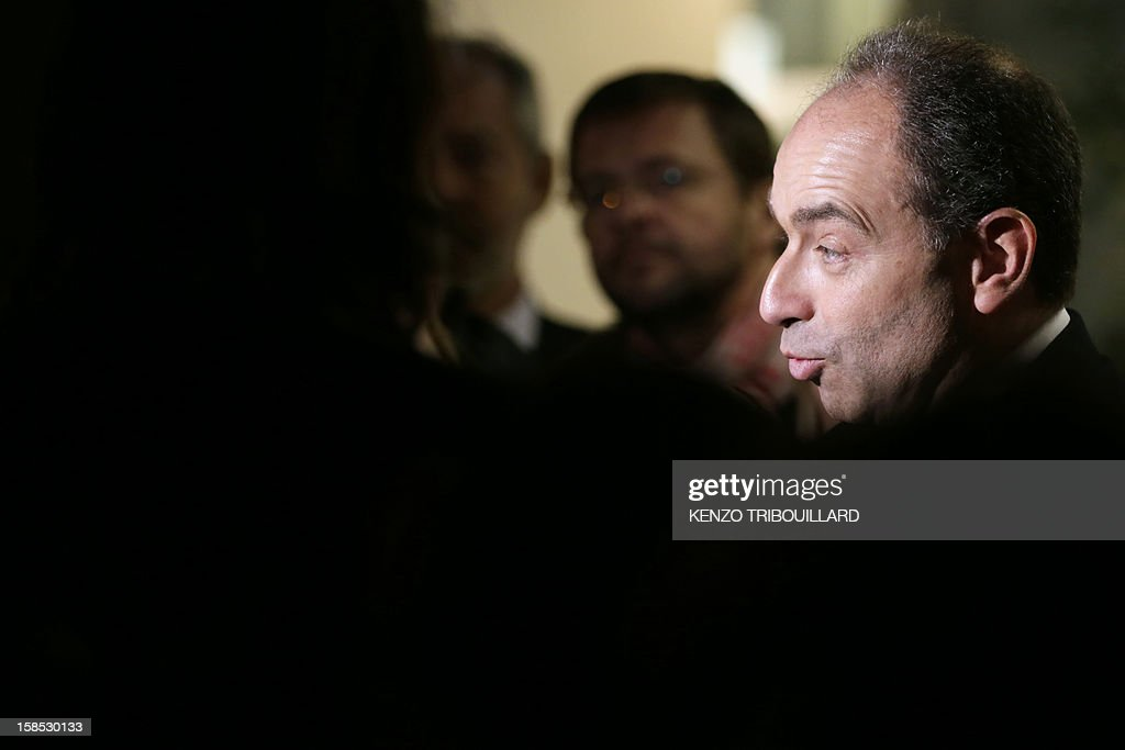 UMP president Jean-Francois Cope (R) answers journalists' questions as he leaves a UMP political bureau which validated a new internal election, on December 18, 2012 at the National Assembly in Paris. Cope and Francois Fillon, the rivals in the leadership row which split French former ruling party, the UMP, agreed on December 17, 2012 to a new internal election after a bitterly-contested first vote last month.