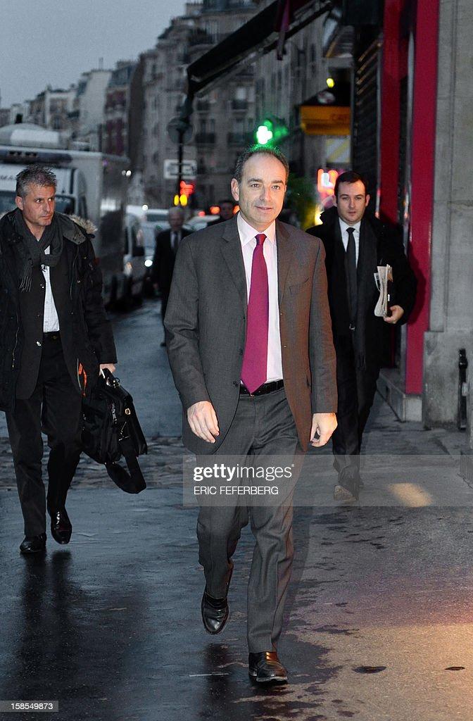 UMP president Jean-Francois Cope (C) arrives at UMP headquarters to attend the UMP's party political bureau on December 19, 2012 in Paris.