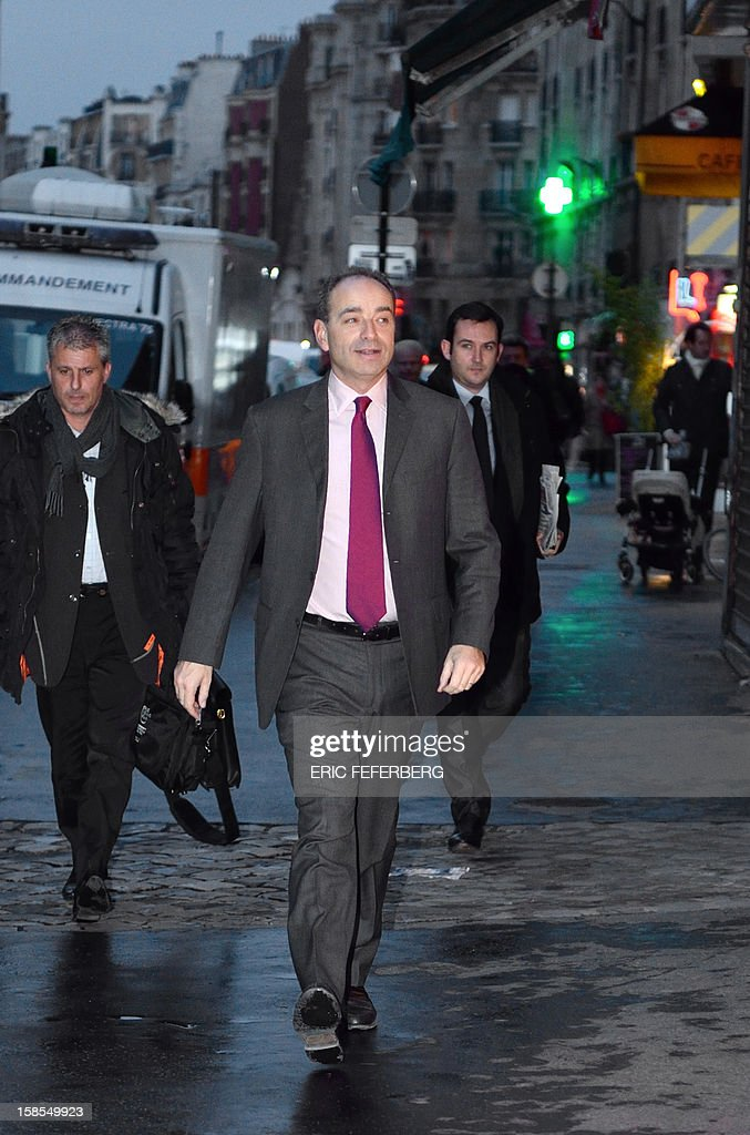 UMP president Jean-Francois Cope (C) arrives at UMP headquarters to attend the UMP's party political bureau on December 19, 2012 in Paris. AFP PHOTO /ERIC FEFERBERG
