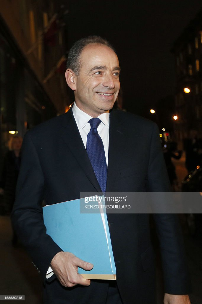 UMP president Jean-Francois Cope (C) leaves a UMP political bureau which validated a new internal election, on December 18, 2012 at the National Assembly in Paris. Cope and Francois Fillon, the rivals in the leadership row which split French former ruling party, the UMP, agreed on December 17, 2012 to a new internal election after a bitterly-contested first vote last month. AFP PHOTO KENZO TRIBOUILLARD