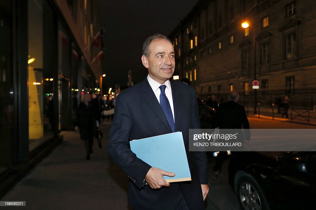 UMP president Jean-Francois Cope (C) leaves a UMP political bureau which validated a new internal election, on December 18, 2012 at the National Assembly in Paris. Cope and Francois Fillon, the rivals in the leadership row which split French former ruling party, the UMP, agreed on December 17, 2012 to a new internal election after a bitterly-contested first vote last month.