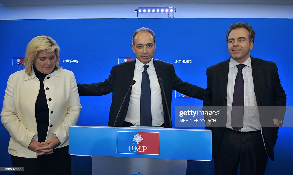 UMP president Jean-Francois Cope (C) stands with UMP general secretary Michele Tabarot (L) and former Education minister Luc Chatel during a press conference at the UMP headquarters on December 18, 2012 in Paris. Cope and Francois Fillon, the rivals in the leadership row which split French former ruling party, the UMP, agreed on December 17, 2012 to a new internal election after a bitterly-contested first vote last month. AFP PHOTO