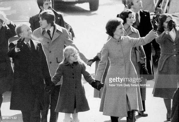 President Jimmy Carter and Rosalynn walk with daughter Amy in inaugural parade