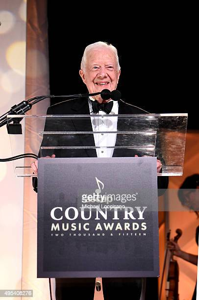 President Jimmy Carter presents Trisha Yearwood with the Voice of Music Award during the 53rd annual ASCAP Country Music awards at the Omni Hotel on...