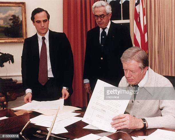 President Jimmy Carter Signs a Document Demanding the Release of Americans Held Hostage in Teheran Iran