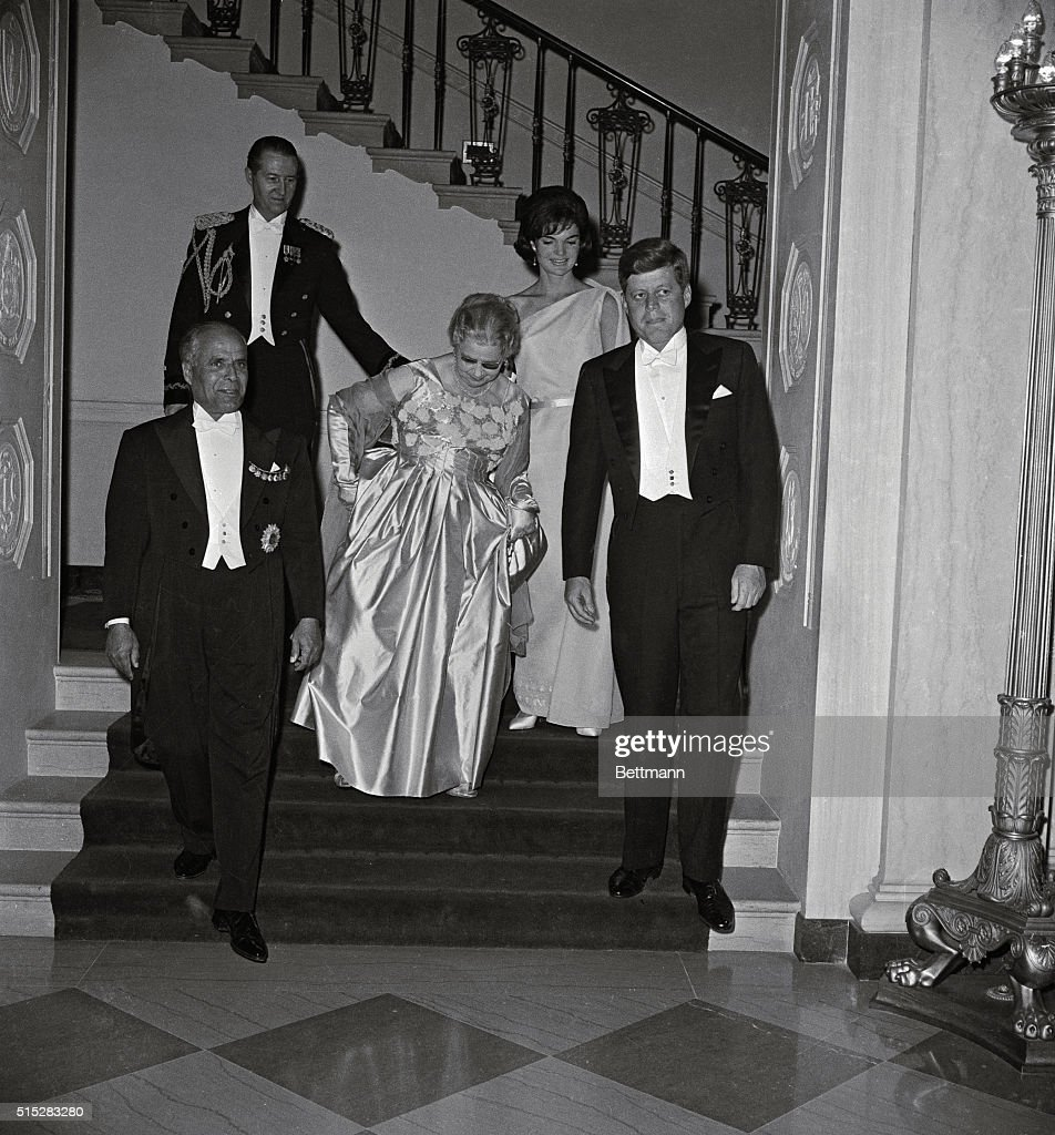 President John and First Lady <a gi-track='captionPersonalityLinkClicked' href=/galleries/search?phrase=Jacqueline+Kennedy&family=editorial&specificpeople=70028 ng-click='$event.stopPropagation()'>Jacqueline Kennedy</a> enter a state dinner with the guest of honor Tunisian President <a gi-track='captionPersonalityLinkClicked' href=/galleries/search?phrase=Habib+Bourguiba&family=editorial&specificpeople=213571 ng-click='$event.stopPropagation()'>Habib Bourguiba</a> and his wife.